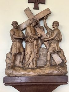 Jesus carries his cross